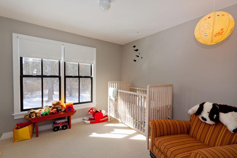 The kids will love playing in this children's room, complete with toys and a crib