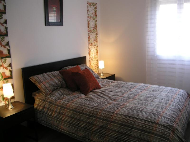 The double bedroom which has electric shutters