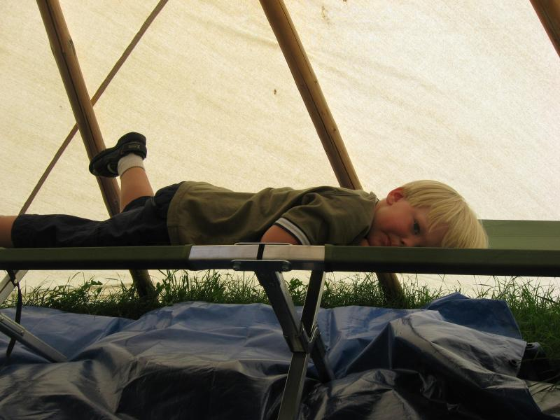Resting on a cot in tee pee