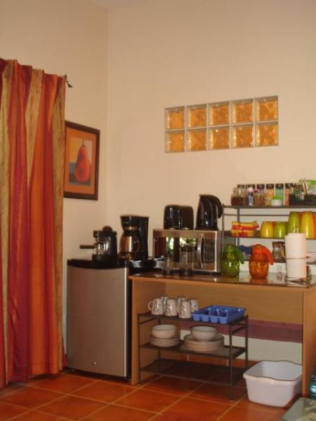 Microwave, toaster, electric kettle, french coffee press, dishes and silerware