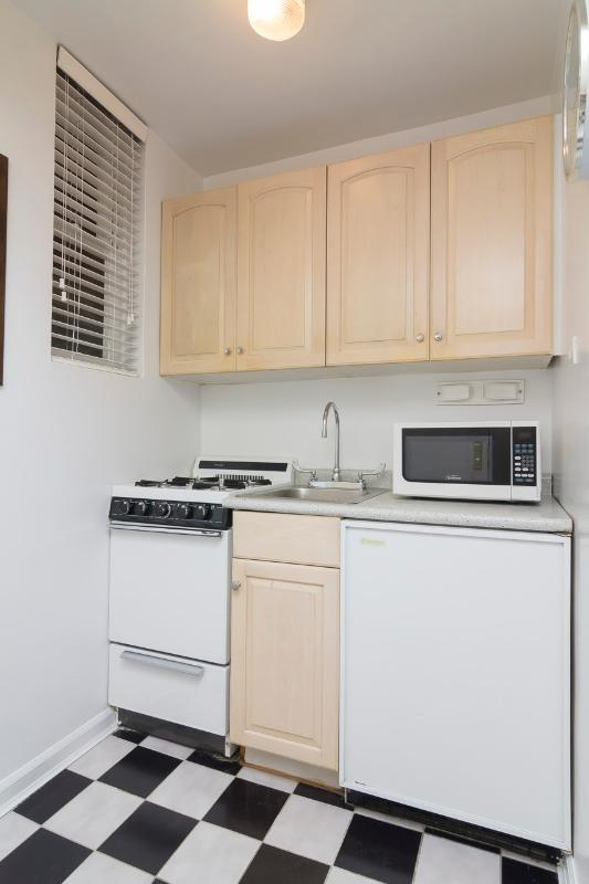 Kitchen includes cookware and appliances