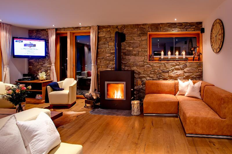 Large living area with 3 seating areas and fire place