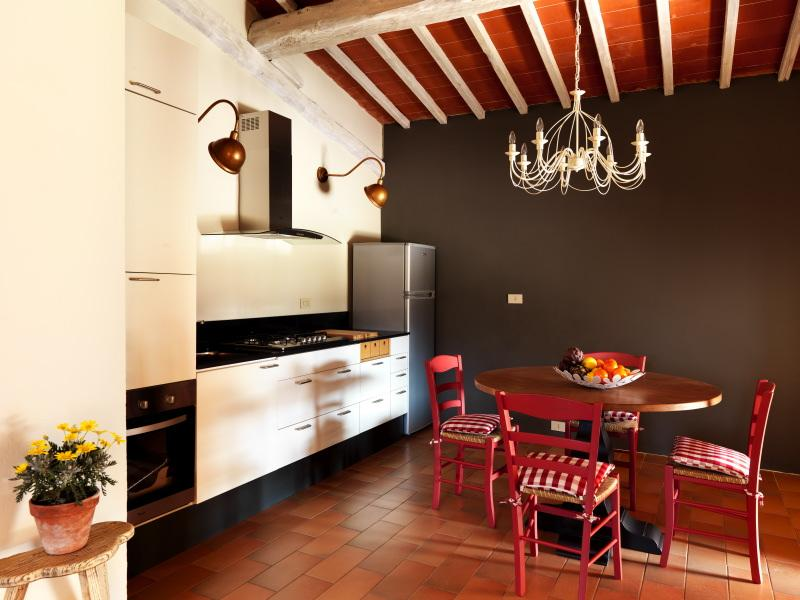 The Kitchen. Outside, a fabulous loggia with private barbecue are reserved to the guests .