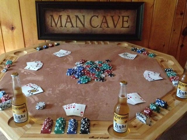 The second living room contains a gaming table for board games or poker
