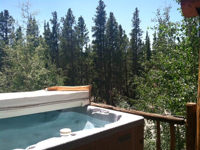 Hot tub on open deck - stars and scenario while you soak in luxury!