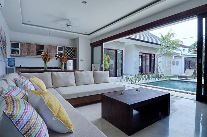Open-plan living in the villa allows view over pool and gazebo