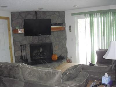 Cozy Wood Burning fireplace and HDTV