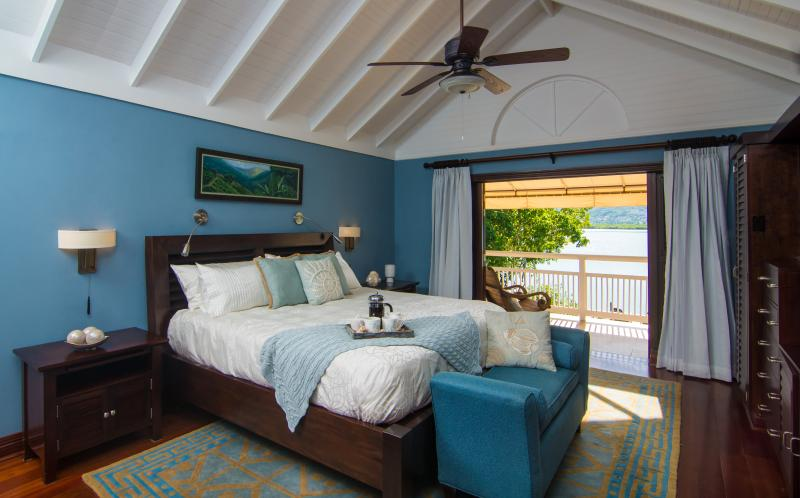 Master bedroom with king bed and tv. View to the gorgeous water from the master