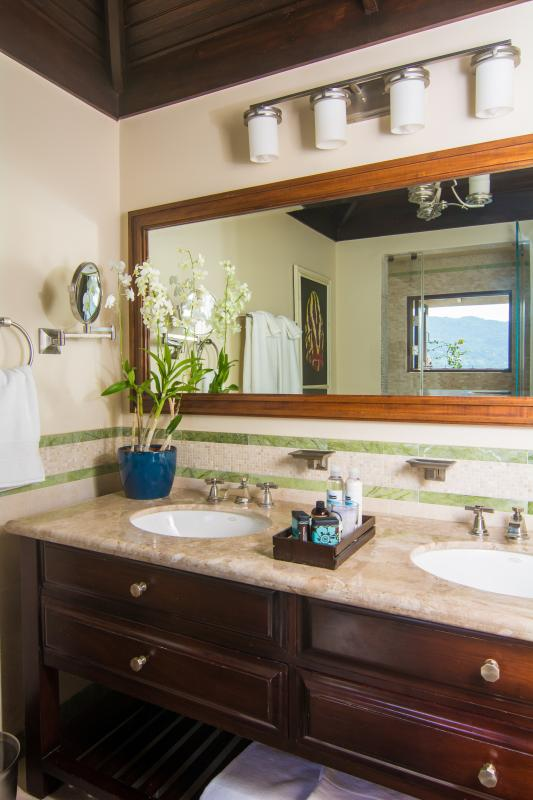 Master bathroom with double sinks and steam shower