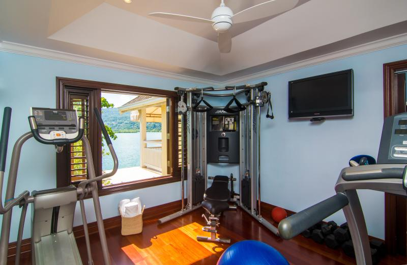 Gym (right off of the master) with tv, ac, treadmill, elliptical machine, weight machine and weights