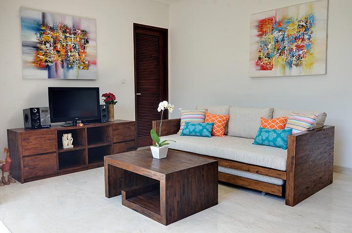 A Sanur artist's work  brightens the living space which has cable TV, iPod dock and DVD player