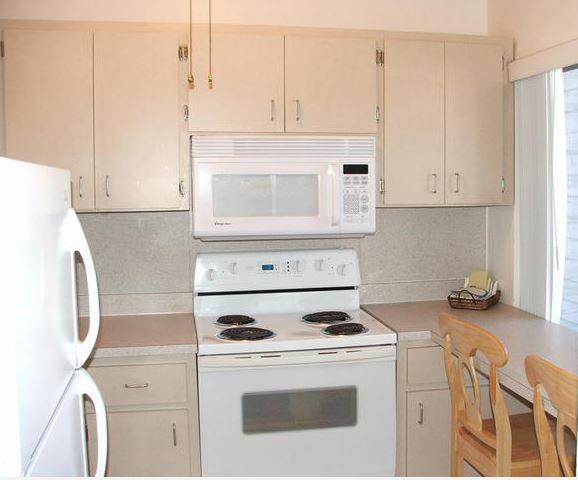Kitchen has full size refrigerator, stove, microwave oven, dishes, pots and pans, toaster etc.