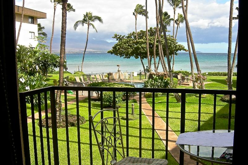 View of courtyard,  Haleakala volcano, and ocean from condo lanai.