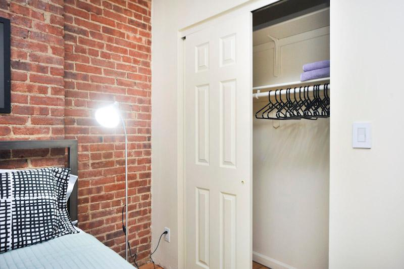Closet in Second Bedroom, standing lamp next to bed