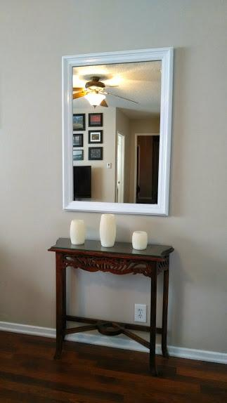 Entry accent table with (battery-operated) candles come on each evening.