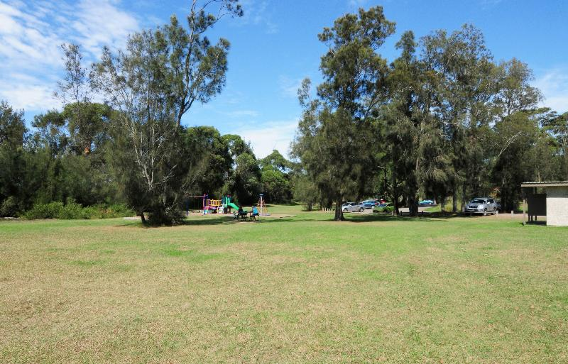 Plantation Point - grassed area featuring picnic tables, BBQs and kid's playground
