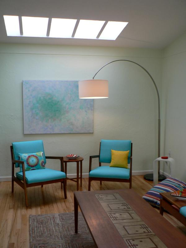 The living room skylight creates a light-filled space, east and north windows look on gardens.