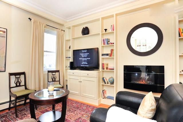 custom built wall unit and cozey fire place area