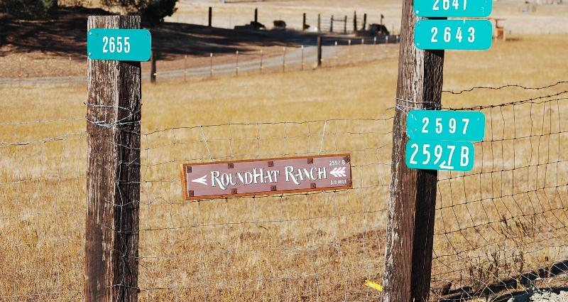 Sign @ Old Hwy & RoundHat ranch road- turn down ranch road to RoundHat Entrance .4 milee