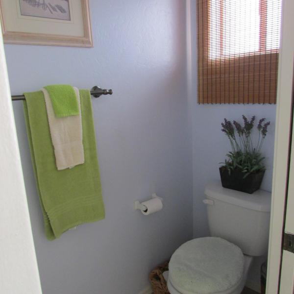 Half Bath/Powder room off of Laundry room and kitche n