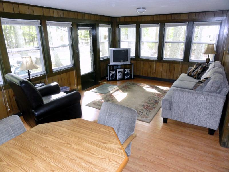 Panoramic view into woods, all new furniture throughout house.