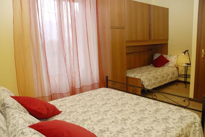 Triple bedroom with balcony