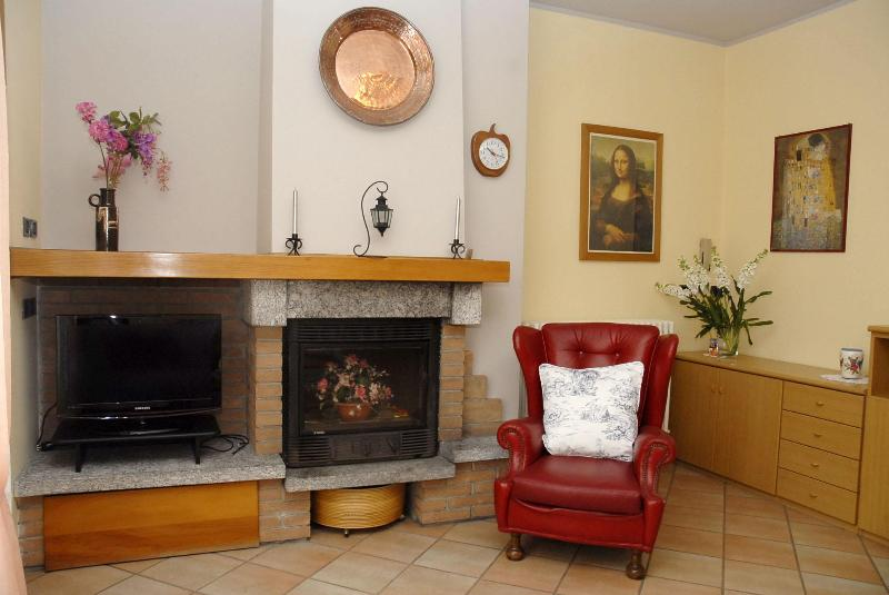 Livingroom with flat screen TV and fire place