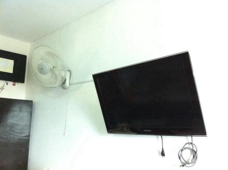 Samsung LCD TV , wall fan , 4 door cabinets