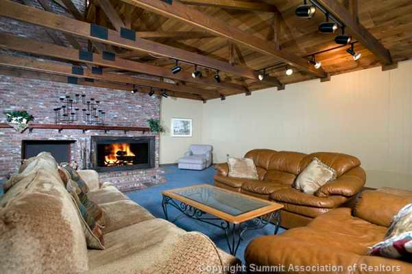Clubhouse w large fireplace, kitchen, bar, pool table