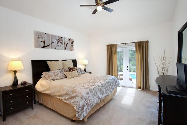 Masterbed Room Downstairs with private exit to pool area