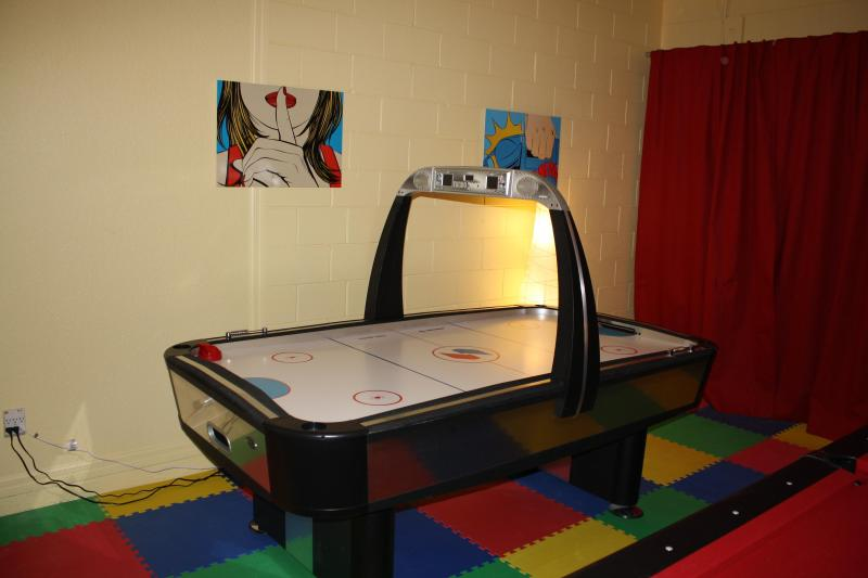 Air Hockey in the game room