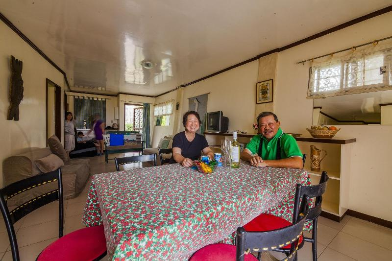 Herr and Leonie Bautista in the dining - living room.