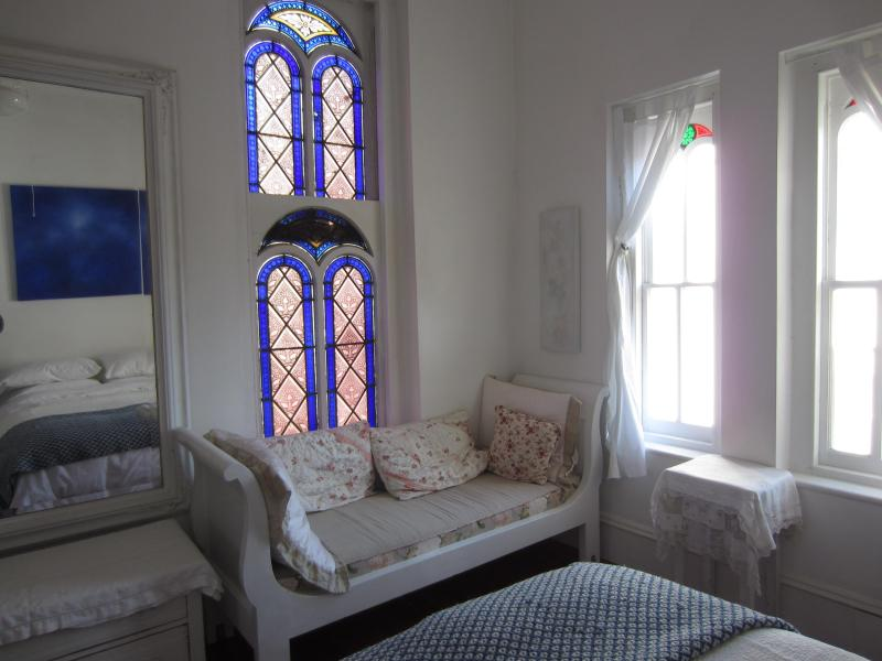 Stained glass windows and Sleigh Bed