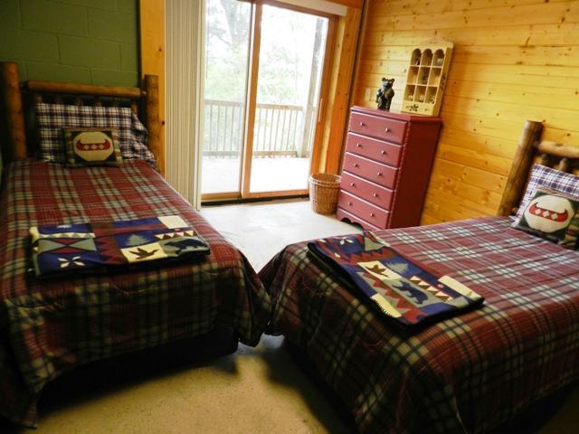 Twin log beds on lower floor
