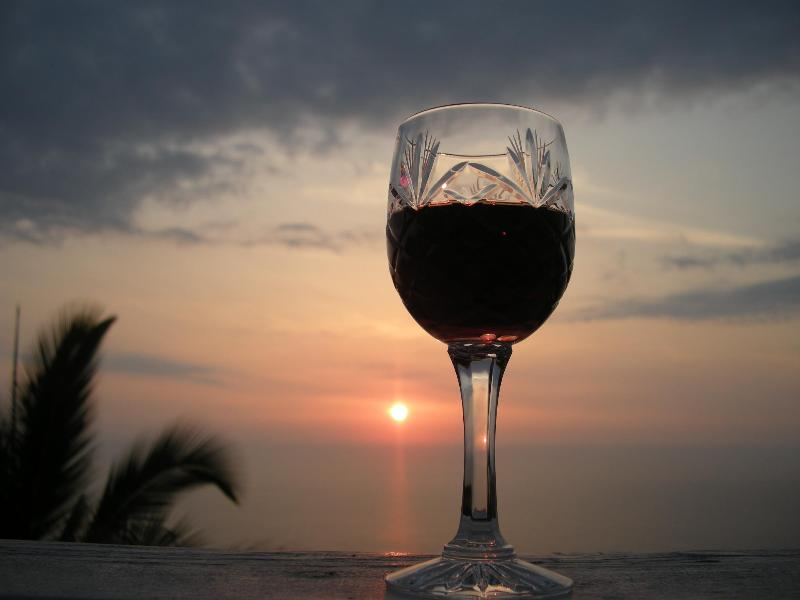 Wine and/or cocktails at sunset is an island tradition.