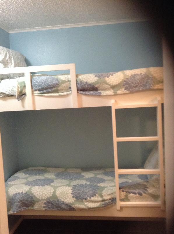 Twin bunk beds in hallway