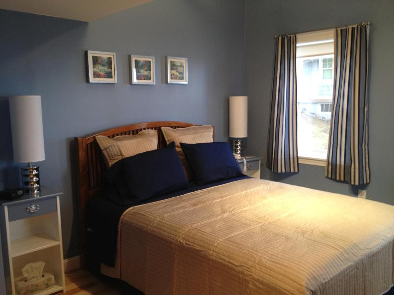 Master bedroom with Queen bed, waterview, ample closets and satelite TV