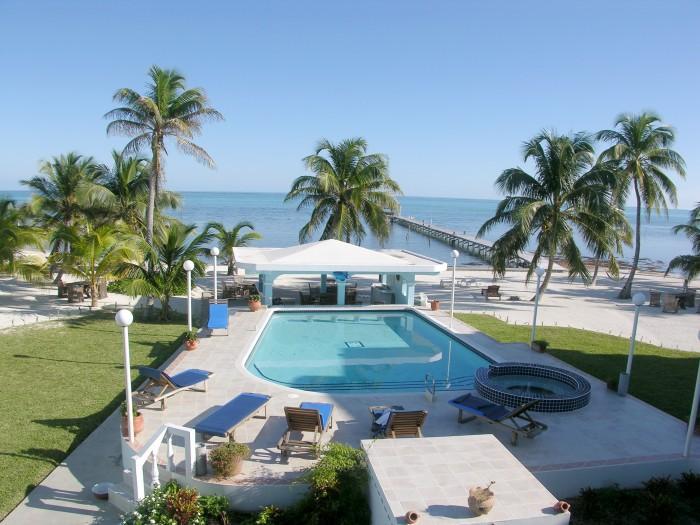 View from condo veranda view of pool, beach & sea!