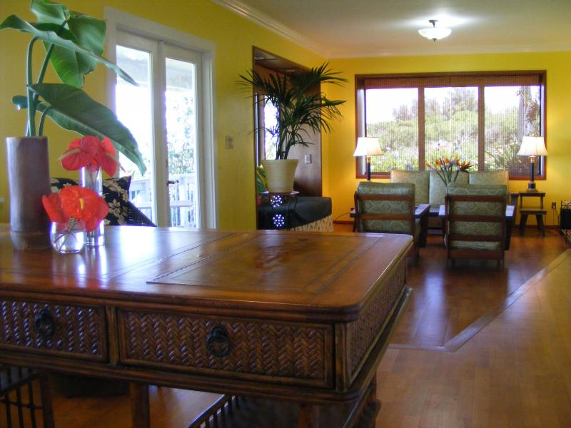 Living room with heirloom koa furniture viewed from the study
