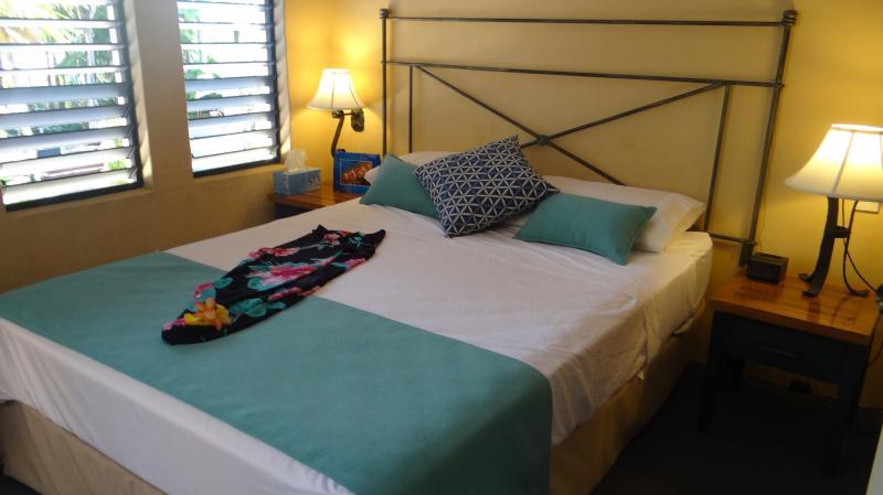 Master bedroom overlooking pool doors to private balcony and separate door to bathroom as ensuite