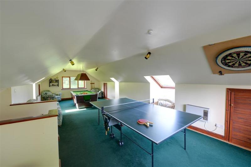 The shared games room with table tennis and pool table can be enjoyed by the whole family
