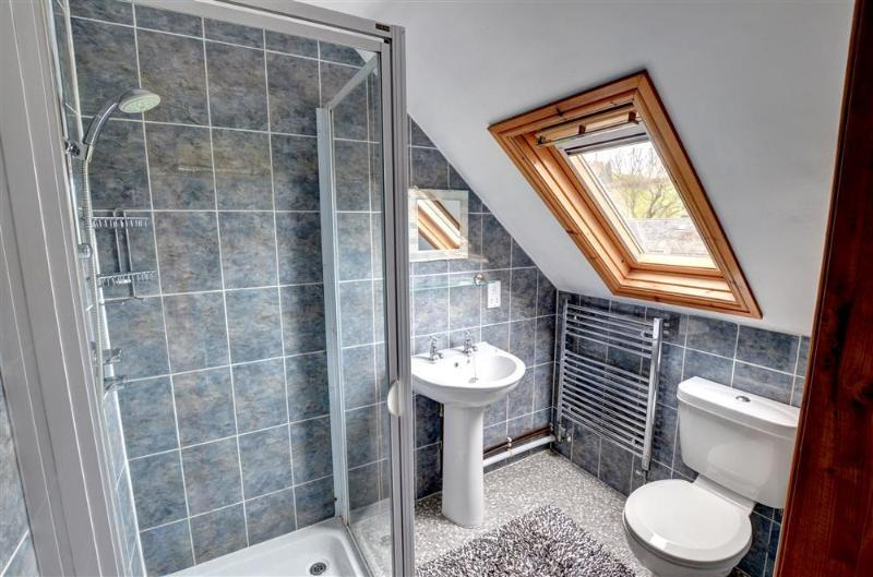 The double bedroom has a smart en suite with good-sized shower cubicle