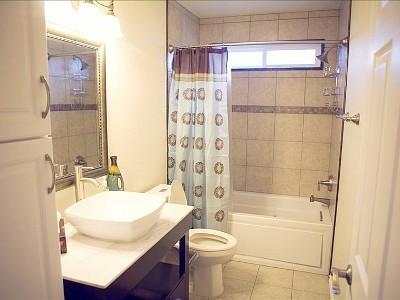 Badkamer met jacuzzi badkuip