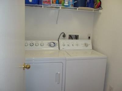 Unit has Laundry Room with Full Size Washer And Dryer.
