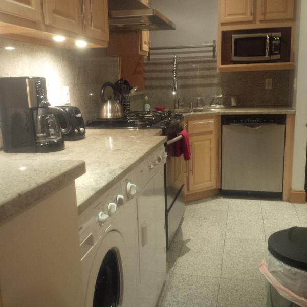 kitchen counters, washer and dryer