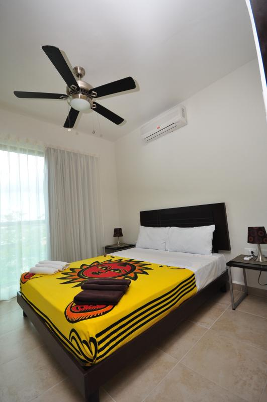 Comfortable rooms with air conditioning and ceiling fan