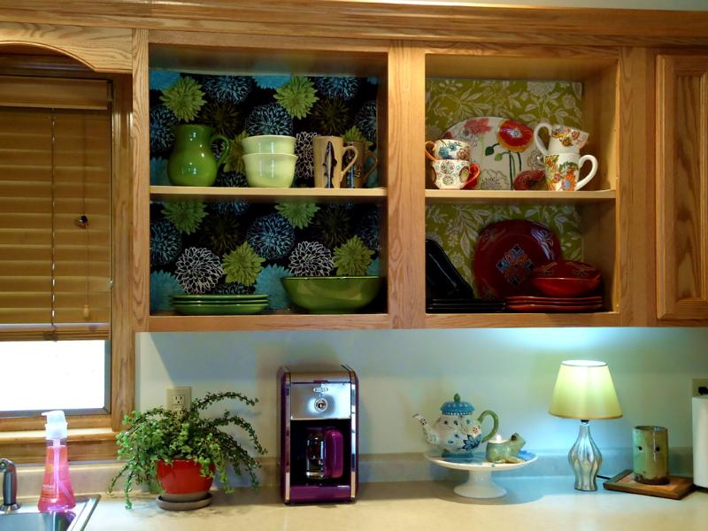 Open shelves display an eclectic mix of dishes for your use