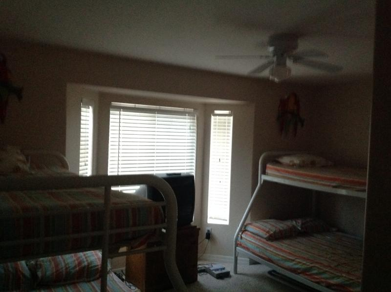 Bedroom with 2 bunk beds fully on bottom twin on top
