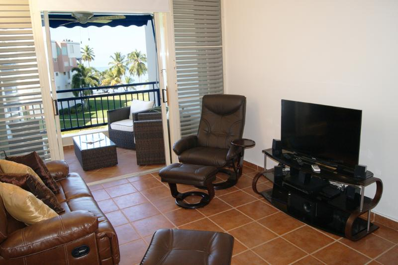 Livingroom area has big flat screen TV, home theater and high speed WiFi internet.