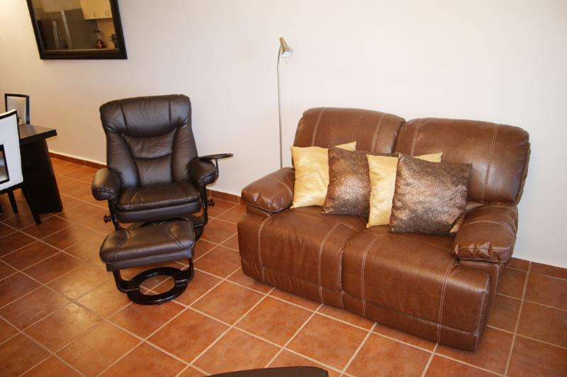 Closer look to leather recliner sofa and chair.